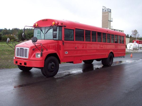 Red converted school bus used for transporting patients in mass injury situations