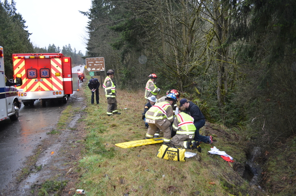 Ambulance and crew at roadside rescue