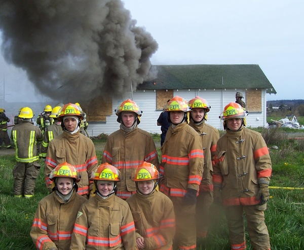 Explorer Scout Post 1003 posed in front of house after fire extinguished
