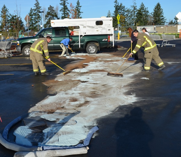 Haz-mat crew containing and cleaning-up a hazardous material spill