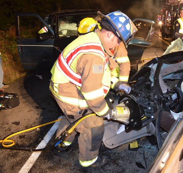 Tech rescue team works to remove victims from vehicles in auto accident