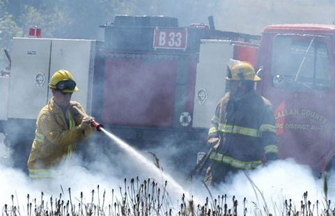 Two firefighters in wildland firefighter training
